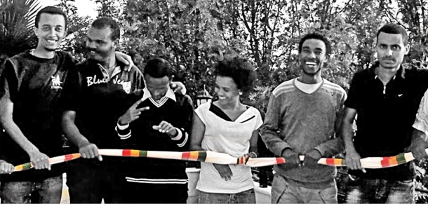 The Detained ZONE 9 Bloggers holding a ribbon of the Ethiopian flag